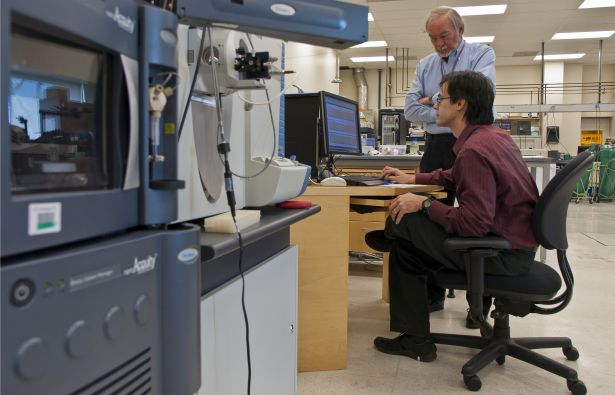scientists with equipment in Burlingame Lab