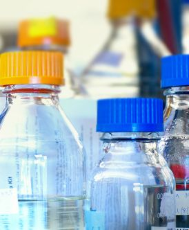 closeup of storage bottles used in scientific research